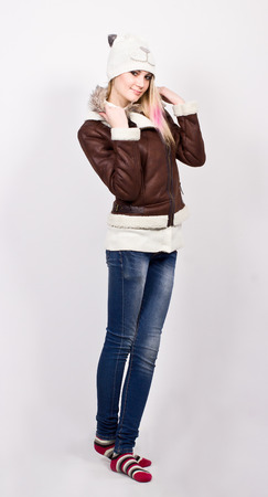 Beautiful slim girl standing in winter clothes photo