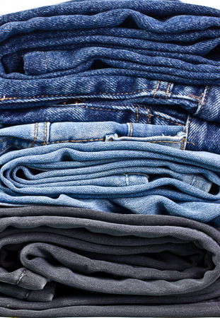Stack of Three Various Washes Folded Jeans photo