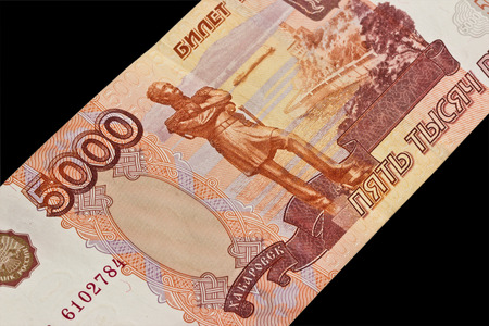 Russian money: five thousand rubles on a black background photo