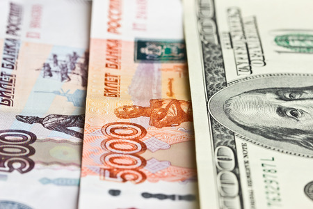 Hundred dollars, five thousand and five hundred rubles as a background photo