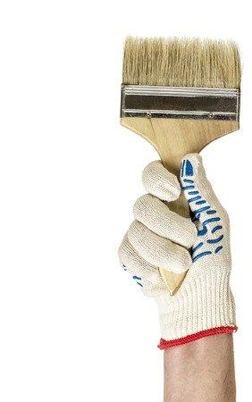 Hand with paint brush, isolated over the white background photo