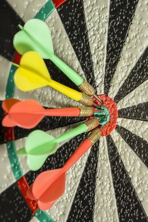 bullseye: Darts arrows in the target center