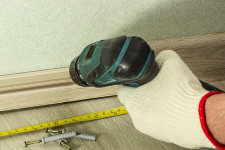 skirting: Screwing Chipboard. Fixing skirting board for the wall