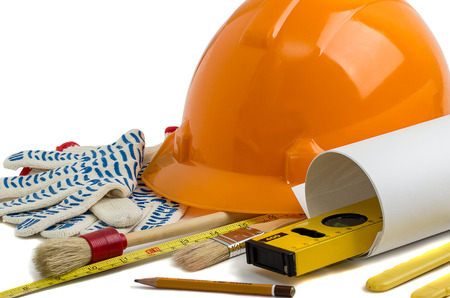 Construction helmet and tools. background photo