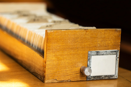 Old archive with wooden drawer in a library photo