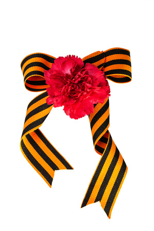 Carnation and bow of St. George Ribbon on a white background photo