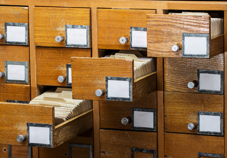 Open boxes in the old archive.  library card or file catalog.