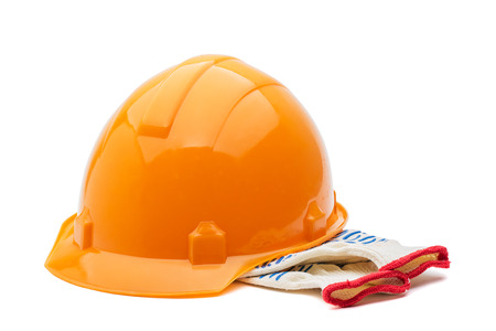 Construction hard hat and gloves on a white background photo