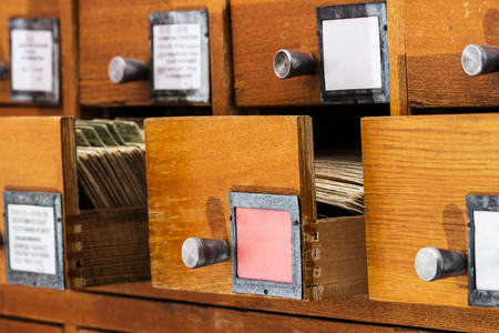 card file: Open boxes in the old archive.  library card or file catalog.