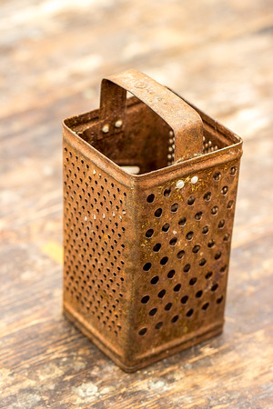 grater: Old rusty grater. Closeup, rustic Stock Photo