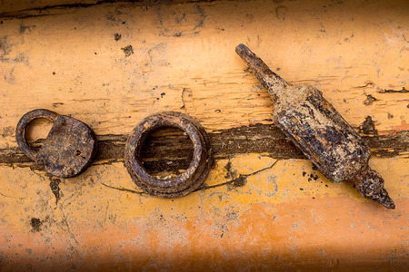 old items: Old rusty items on a wooden background