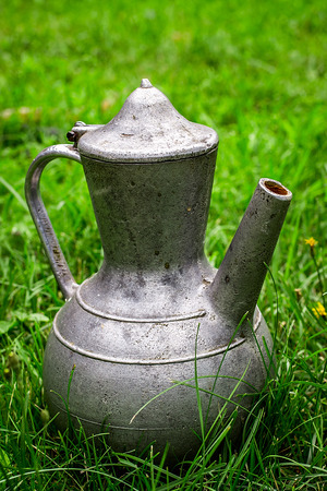 old items: Old metal pitcher. vintage items Stock Photo