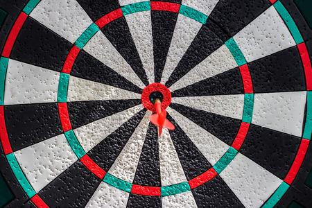 dart on target: Darts arrows in the target center