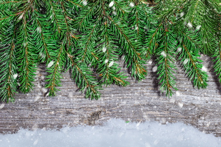 firtree: Wood texture with with  firtree  and snowflakes Stock Photo
