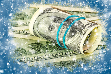 one hundred dollars: One hundred dollars on a blue winter background