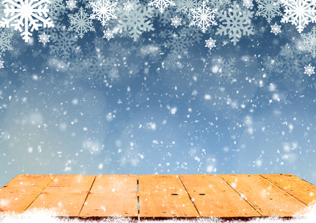 christmas wallpaper: Blue Christmas background with wooden table and white snowflakes
