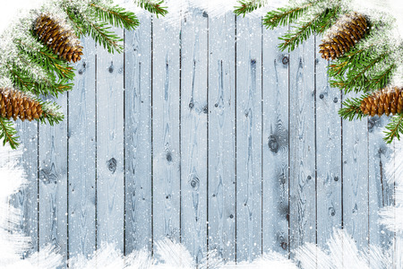 Wooden board with branches of fir. Copy space. Christmas background with an inscription