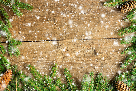 christmas snow: Christmas background on wooden boards with snowflakes