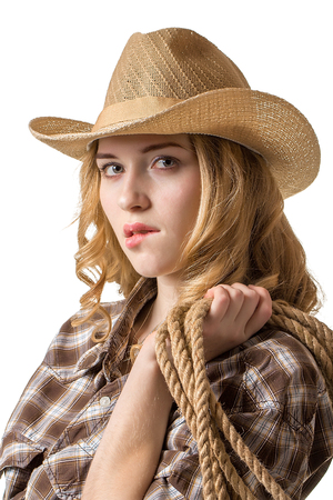 beautiful blonde: Young lady with long hair  in a cowboy hat on white background Stock Photo