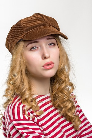 cute lady: Beautiful girl with long hair in a brown cap. on white background