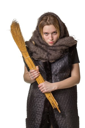 uptight: Angry woman in a scarf with a broom in his hand on white background