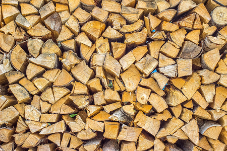 woodshed: Firewood texture background. Chopped firewood birch, poplar and larch stacked in woodshed and snowbound Stock Photo