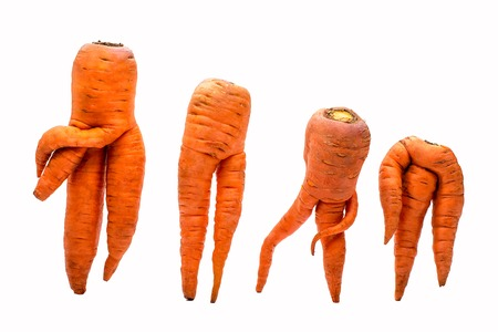 Unusual crop of carrots isolated on white background Stock Photo