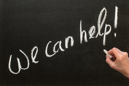 warranty questions: WE CAN HELP text written on chalkboard Stock Photo