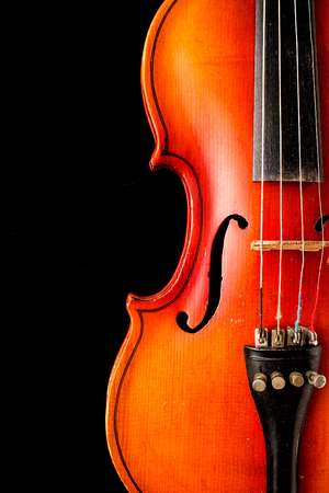 Old violin on a black background Stock Photo