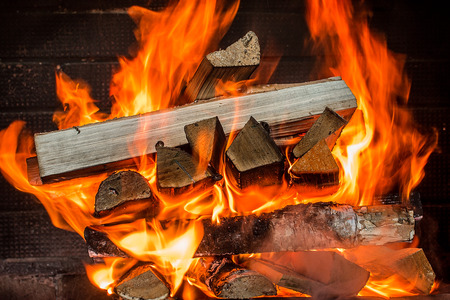 outdoor fireplace: Burning firewood in the fireplace close up. fire, burning charcoal background, barbeque grill