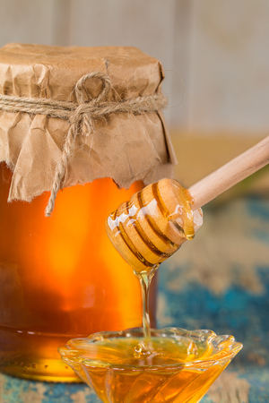 drizzler: Honey in a pot or jar on kitchen table Stock Photo