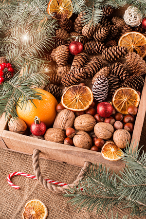 Box with Christmas decoration, nuts, cones and ornaments. Christmas concept Stock Photo