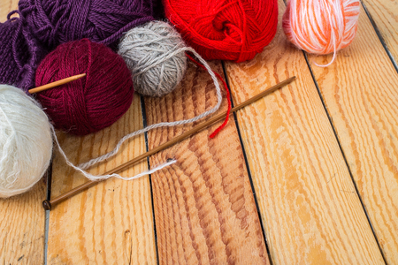 Colorful yarn balls on a wooden background Stock Photo
