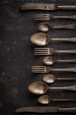 Vintage kitchen cutlery  on stone table, top view, horizontal. Flat lay