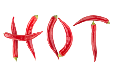 Red hot chilli peppers spelling the word hot. Red and spicy chili pepers creating a word hot on white background Stockfoto