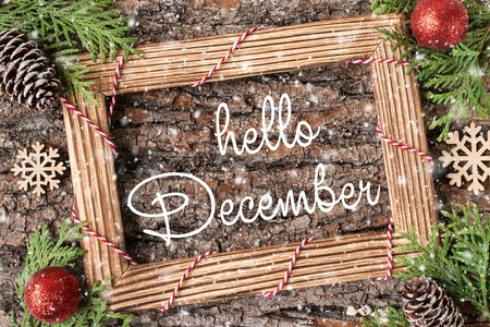 HELLO DECEMBER handwritten inscription. Winter holiday composition. New Year and Christmas celebration. Winter holidays concept. Christmas decorations. Top View.