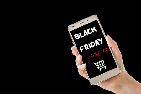 Hand holding cellphone with black friday text