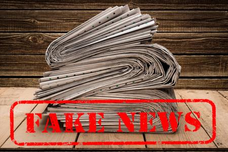 Fake News Fake Post Fact.  stamping that says Fake News. Stock Photo