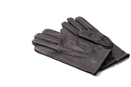 Pair of mens black leather gloves isolated on white background. black new leather gloves on white