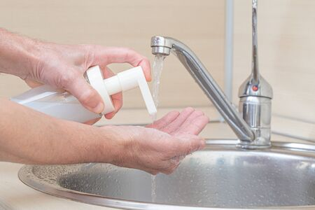 Coronavirus pandemic protection by cleaning hands frequently. Stock Photo