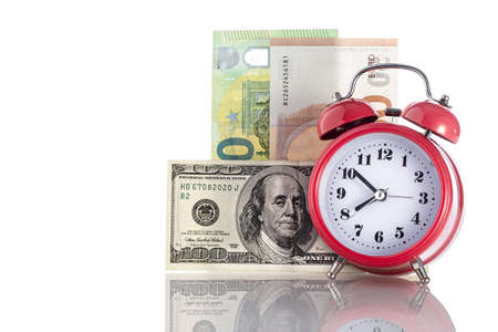 Time is money. Retro alarm clock on table and money background. business financial ideas concept with alarm clock. with free copyspace for your creativity ideas text