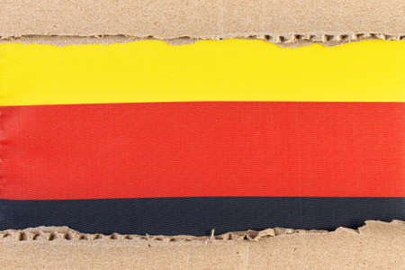 Torn paper with National flag of Germany. Travel concept with Germany Flag. Education and business. Torn paper with Germany National Flag 写真素材 - 154292359
