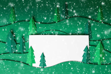 3D pop out Christmas trees paper artwork in green background.