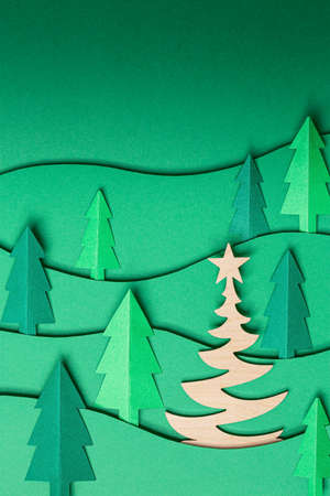 3D pop out Christmas trees paper artwork on green background. 写真素材 - 157386467