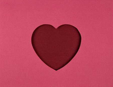Cutted paper heart on red background, paper cut out art style. Valentines Day card, paper cutting. Flat lay, top view, copy space. Valentine Day Paper Art