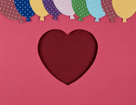 Paper cut in the shape of red heart and balloons on the pink background. Valentines Day card, paper cutting. Flat lay, top view, copy space. Valentine Day Paper Art