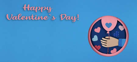 Hand holding a pink paper balloons in overlap blue round hole, pink circle frame. Holiday, birthday, valentine concept. Paper art and origami style. Celebrate events banner posters. Long wide banner