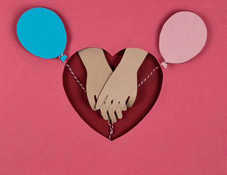 Valentines Day card. Creative paper cut background with bright paper balloons and look of the lovers hands. Holding hands on red heart. Paper art on valentine day. paper cut and craft style