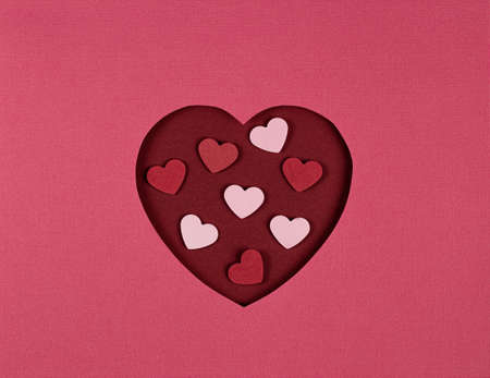 Cutted paper heart on pink background. Paper art on valentine day. paper cut and craft style. Space for text. Valentines Day card. Holiday, birthday, valentine concept