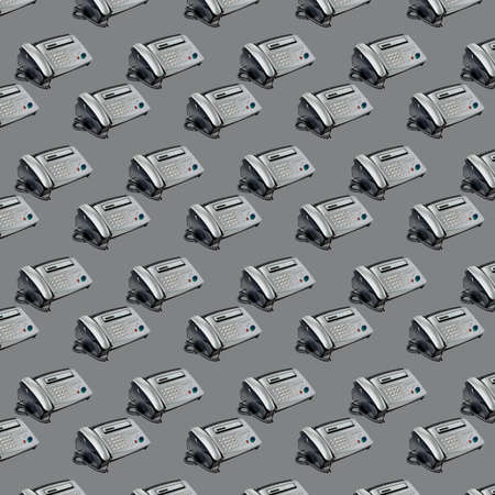 Old office fax machine shot on gray background. seamless pattern with Fax. office equipment 写真素材